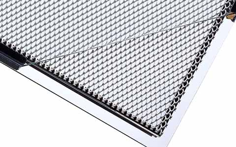 Insulating Glass with Expanded Metal Insert